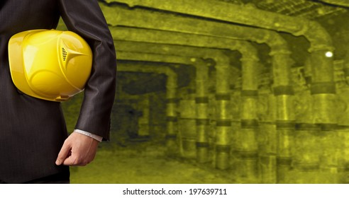 Man working in oil or gas refinery, turning on and off the pipeline valve torso and hand engineer yellow helmet for workers security construction worker No face Unrecognizable person
