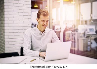 Man working on computer desk in start-up