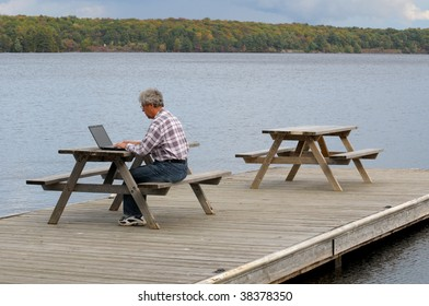 Man working on computer at a dock