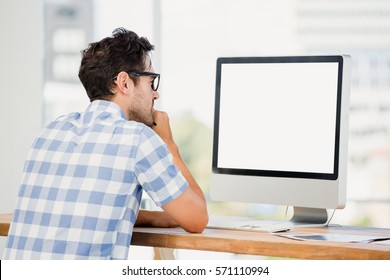 Man working on computer in office