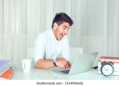 Man working on computer ready press delete enter button isolated white green office background. Funny funky crazy looking boy excited what she see on laptop screen browsing internet. Face expression