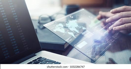 Man working on futuristic digital tablet