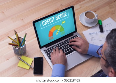 Man working on laptop with CREDIT SCORE on a screen