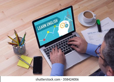 Man working on laptop with LEARN ENGLISH on a screen