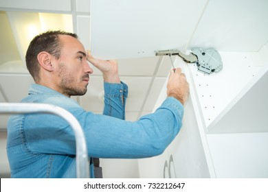 man working on a new kitchen installation
