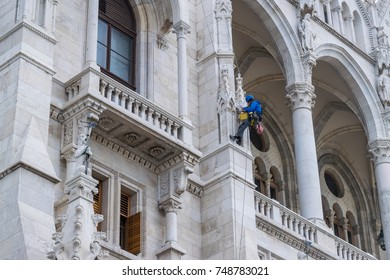 Man working on an old building of the Hungaryan Parliament in Budapest on September 2017