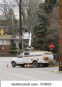 Man Working on Power or Communication Lines from Bucket Truck