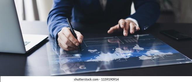 Man working on progect using high technology digital tablet
