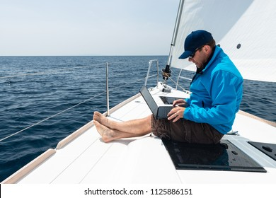 Man working on sail yacht