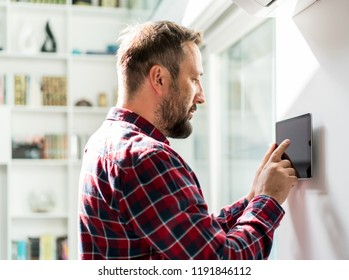 Man working on smart home device