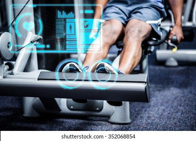 Man working out in gym against fitness interface