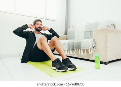 Man working out at home doing sit ups