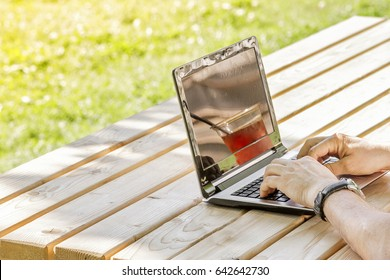 Man working outdoors with laptop