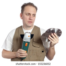 The man in working overalls with the detachable machine and saw disks