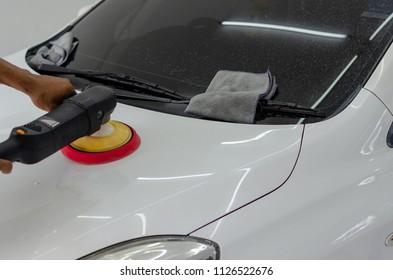 Man working for polishing, coating cars.