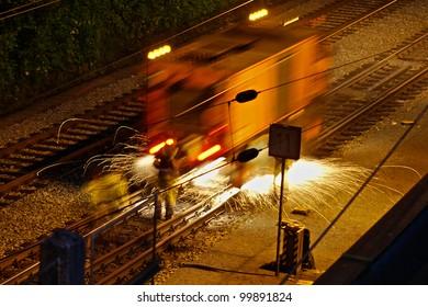man working at rails at night