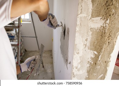 Man Working And Redecorating A House