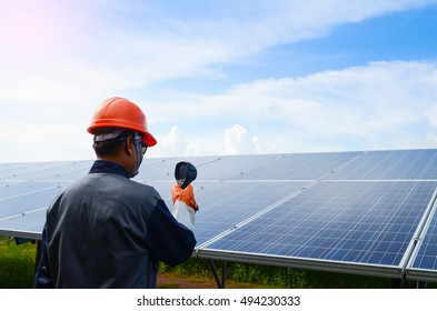 A  man  working  at solar panels