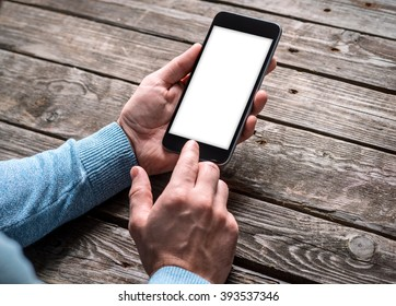 Man working with touchscreen of a smart phone. Clipping path included.
