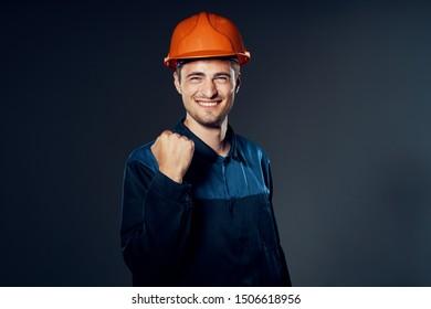 Man working uniform orange helmet construction