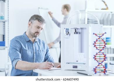 Man working using 3D printer in testing laboratory