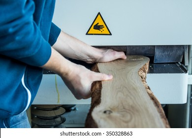 Man working with wood machine. Unsafe work with machine