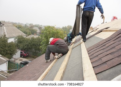 Man works at height. Dangerous work at altitude. A man works without protection. Violation of safety precautions.