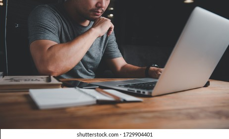 Man works with a laptop computer with determination and concentration. concept work form home, stay at home.night time.The concept of working at night is quiet and without any disturbances.