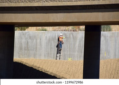 A man works on a concrete wall barrier of the new highway in Kern County. Construction progress of the new Centennial Corridor, Bakersfield, CA, October 1, 2018.