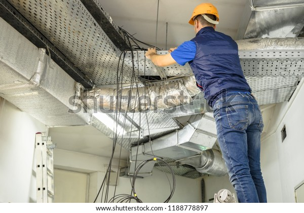 Man Works Wires Near False Ceiling Stock Photo (Edit Now ... on