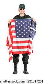 Man in workwear stands with american flag. Isolated on a white background.
