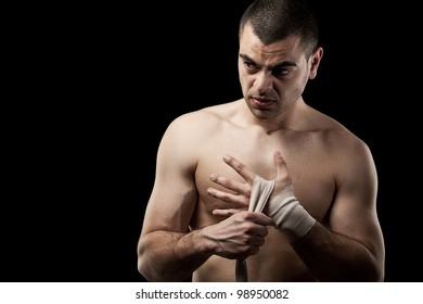 Man wrapping her hands for kickboxing
