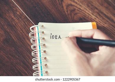 man writeen idea text on notepad