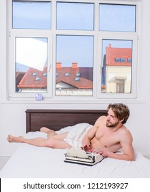 Man writer lay bedclothes work book. Writer enthusiastic author used old typewriter. Create bestseller tips. Full of inspiration or idea. Romantic erotic poem popular genre. Man inspired keep working.
