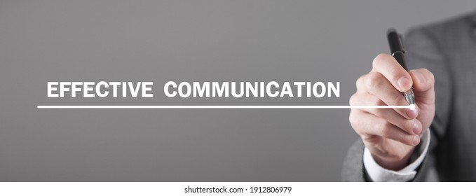 Man writes Effective Communication text in screen.
