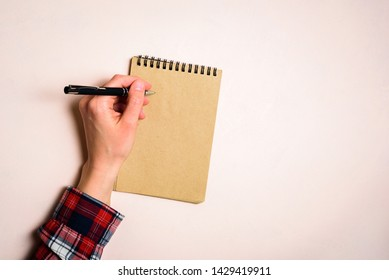 Man writing by left hand. Left hander day concept. Working place of lefty
