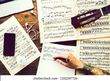 Man writing down notes for a new composition