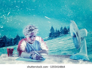 Man writing at his office in the nature, during winter time . Powerful fan causing snow.