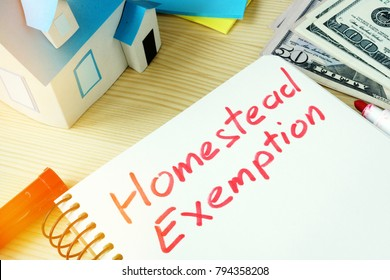 Man writing Homestead Exemption in a note pad.