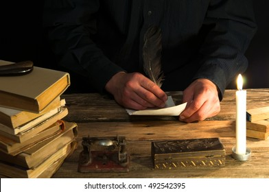 Man writing a letter with quill and sealing. Vintage