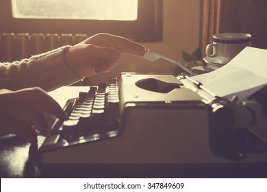 Man writing on old typewriter.