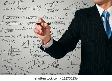 Man writing on the screen. Mathematics
