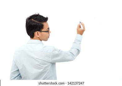 Man writing something on board with marker