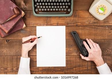 man writing suicide note on desktop