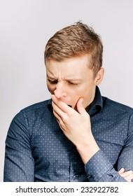 An man yawning