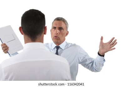 Man yelling at his assistant