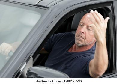 man yelling through the car window