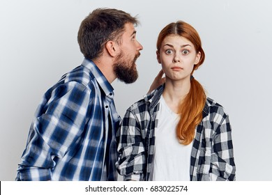 Man yelling at a woman on a light background