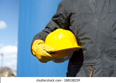 man with yellow hardhat and gloves