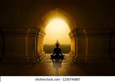 Man with yoga pose in buddhist temple
